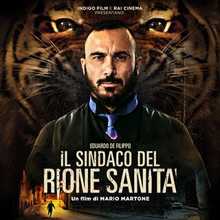 Uomo di fronte con barba con alle spalle una tigre